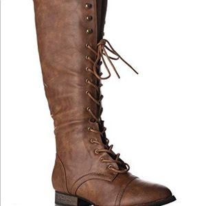 Breckelle's brown lace up riding boot.